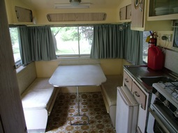 Inside Kookaburra, our 1960's onsite caravan, the table lets down to make a double bed. One of 4 onsite retro caravans at Grampians Paradise Camping and Caravan Parkland