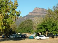 Camping site with shady tree and views of the Grampians and a fire place