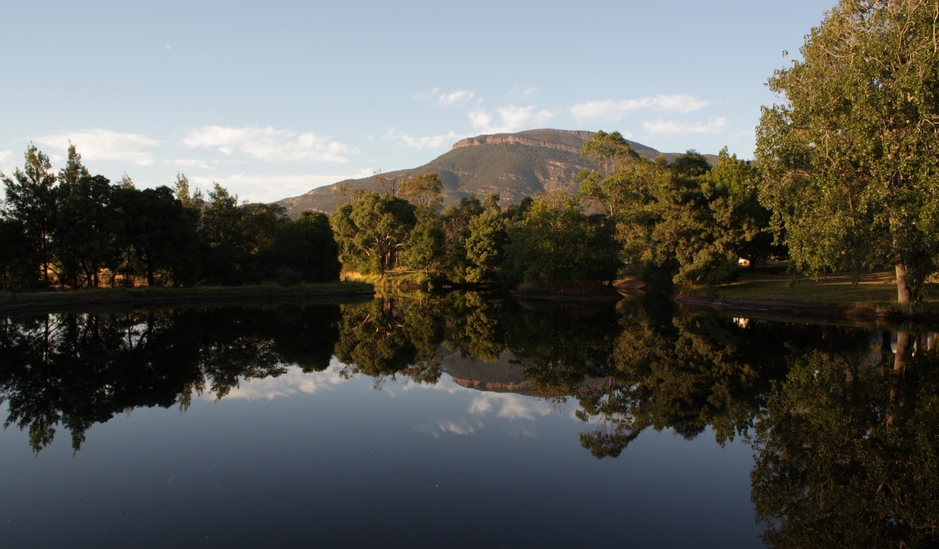 Mt William, the highest mountain of the Grampians National Park, refected in the waters of Blue Lake at Grampians Paradise Camping and Caravan Parkland